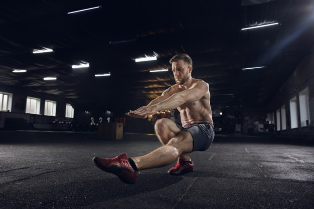 young-healthy-man-athlete-doing-balance-exercises-squats-gym-single-model-practicing-hard-training-his-lower-body-concept-healthy-lifestyle-sport-fitness