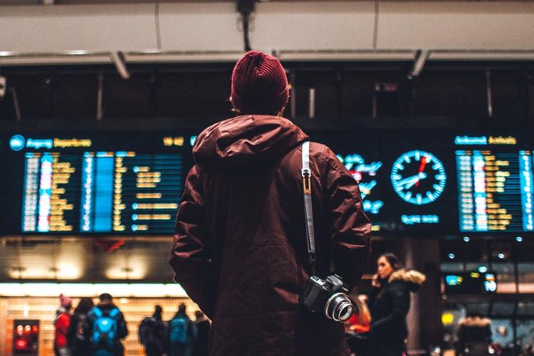 man looking at flight schedule