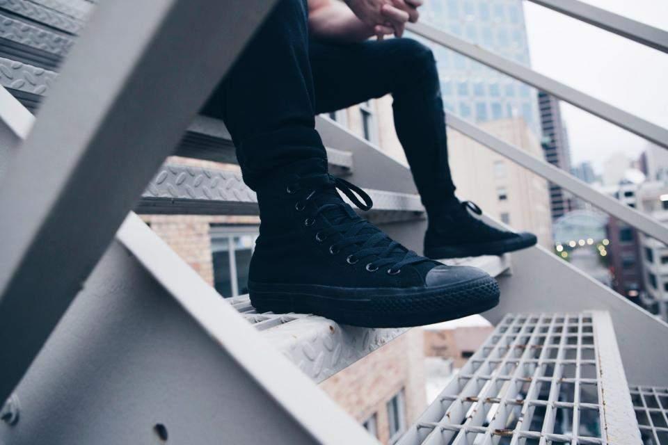 man wearing black sneaker