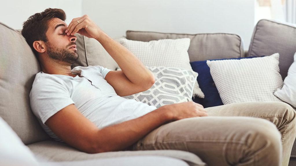 Tired Young Man Feel Eyestrain