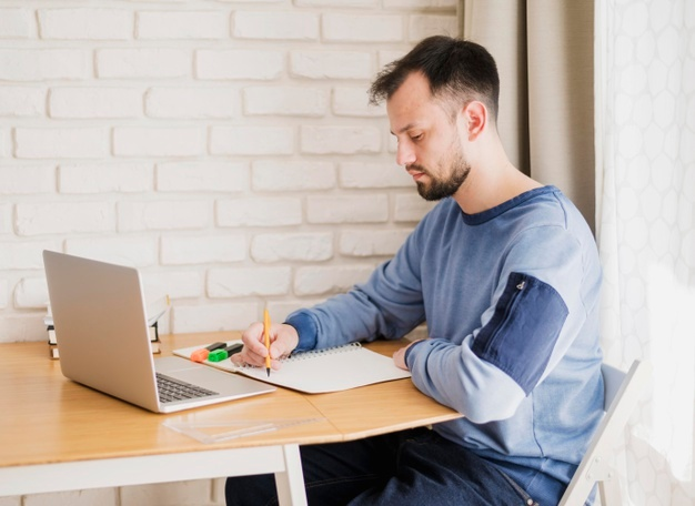 man learning online from laptop