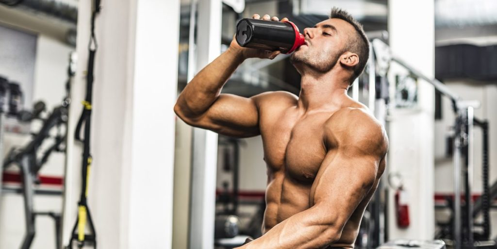 man drink protein shake